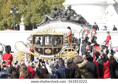 Queen Elizabeth II sits with the Chinese President Xi Jinping in the Diamond Jubilee State Coach following the official welcome ceremony at Horse Guards Parade on October 20, 2015 in London, England.  - stock photo