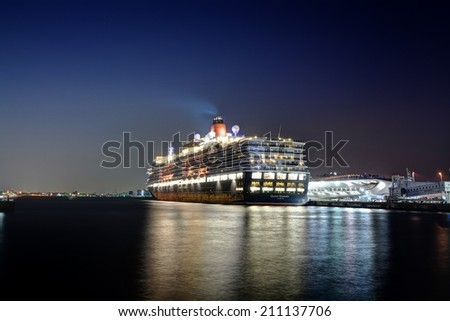 Queen Elizabeth - YOKOHAMA, JAPAN - MARCH 17, 2014 Queen Elizabeth is a Signature class cruise ship operated by the Cunard Line with 90,400 tons - stock photo