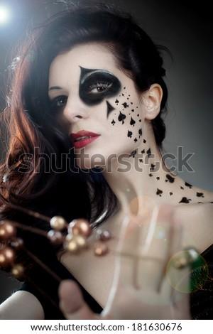 Queen of spades makeup queen - stock photo
