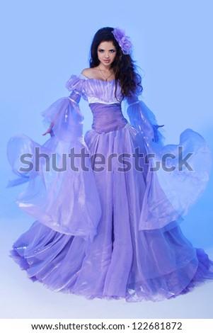 Queen. Young beautiful Caucasian brunette in gorgeous dress, motion shot - stock photo