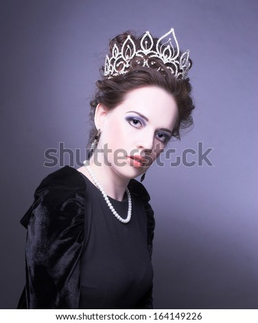 Queen. Young lady posing in crown.