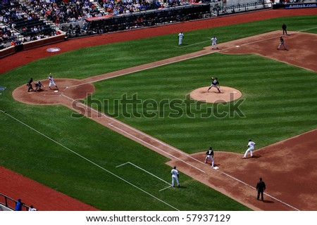QUEENS, NY - APRIL 29: Florida Marlins pitcher Josh Johnson delivers to David Wright of the New York Mets with runners on the corners in a game at Citi Field April 29, 2009 in Queens, NY - stock photo