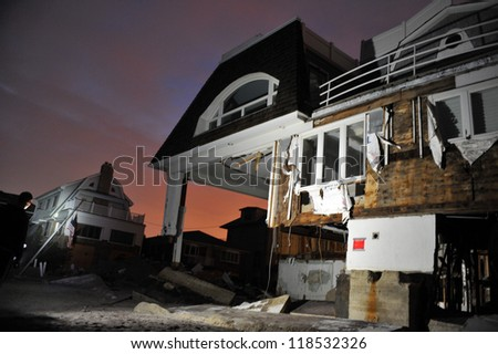 QUEENS, NY - NOVEMBER 11: Damaged houses without power at night in the Rockaway due to impact from Hurricane Sandy in Queens, New York, U.S., on November 11, 2012. - stock photo
