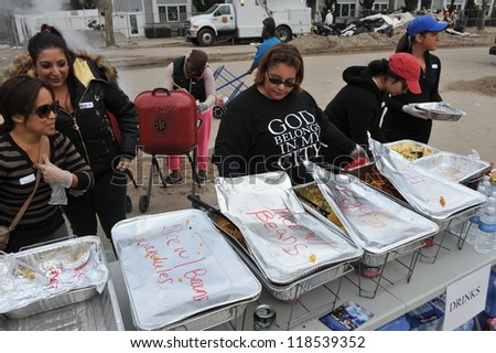 QUEENS, NY - NOVEMBER 11: People getting help with hot food, clothes and supplies in the Rockaway due to impact from Hurricane Sandy in Queens, New York, U.S., on November 11, 2012. - stock photo