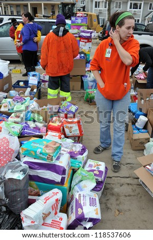QUEENS, NY - NOVEMBER 11: People getting hep with hot food, clothes and supplies in the Rockaway due to impact from Hurricane Sandy in Queens, New York, U.S., on Novemeber 11, 2012. - stock photo