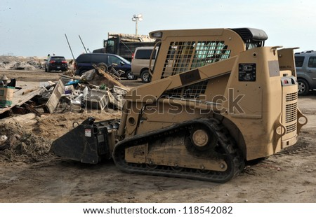 QUEENS, NY - NOVEMBER 11: U.S. Navy working on the streets after massive destruction in the Rockaway Beach area due to impact from Hurricane Sandy in Queens, New York, U.S., on November 11, 2012. - stock photo