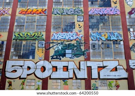 QUEENS - OCTOBER 7: Five Pointz, a world renown outdoor exhibit space featuring the works of numerous graffiti artists October 7, 2010 in Queens, New York. - stock photo