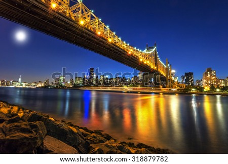 Queensboro Bridge over New York City East River with full moon - stock photo