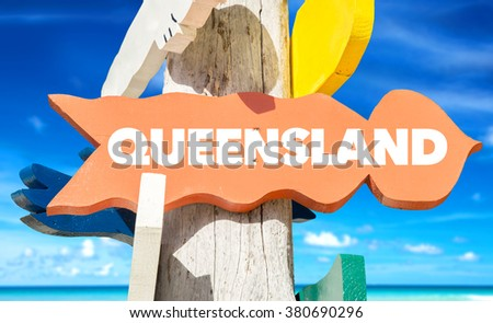 Queensland welcome sign with beach - stock photo