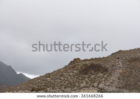 QUEENSTOWN, AUSTRALIA - NOVEMBER 26 : Climate change weather event of unseasonal snow in summer accross Tasmania  November 26, 2015 in Queenstown, Australia - stock photo