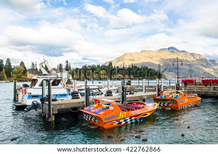 Queenstown,New Zealand - April 22,2016 : Boats parking at the jetty of Lake Wakatipu in Queenstown, New Zealand. - stock photo