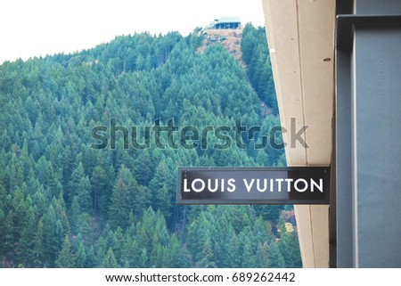 Queenstown, New Zealand-June 10, 2017: Sign of Louis Vuitton with hill background