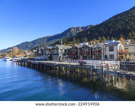 QUEENSTOWN, NEW ZEALAND -MAY 22: Queenstown waterfront on May 22, 2012 in Queenstown, NZ. Queenstown is a world renowned travel destination attracting around 1.9 million visitors every year. - stock photo