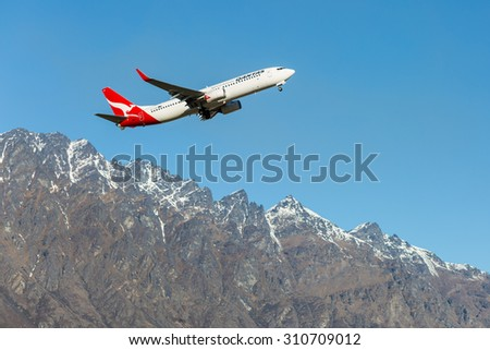 Queenstown, New Zealand - September 1: Qantas plane takes off in Queenstown International Airport on September 1, 2014 in Queenstown, New Zealand.  - stock photo