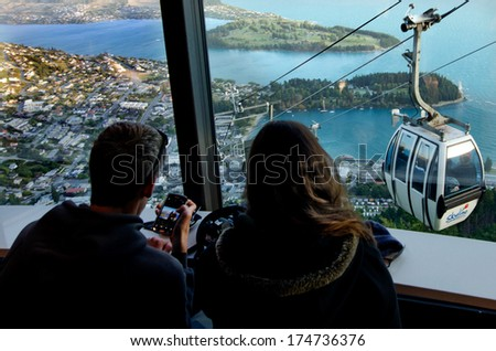 QUEENSTOWN, NZ - JAN 17:Skyline Gondola on Jan 17 2014.It's the steepest cable car lift in the Southern Hemisphere, and one of the must-do activities in Queenstown, NZ. - stock photo