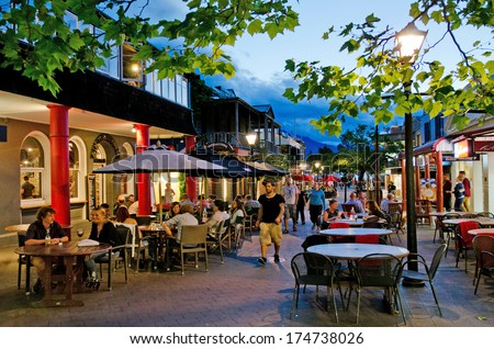 QUEENSTOWN, NZ - JAN 15:Visitors in Queenstown Mall on Jan 15 2014.It's one of the most popular travel destination in New Zealand known for it's restaurants, ski tourism and extreme sport adventure. - stock photo