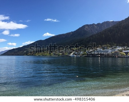 Queenstown Waterfront on sunny spring day crystal clear water