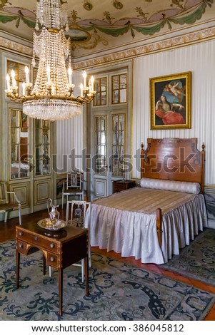 Queluz, Portugal - September 16, 2015: Maria Francisca Benedita Princess bedroom in the Queluz Palace, Portugal. Formerly used as the Summer residence by the Portuguese royal family. - stock photo