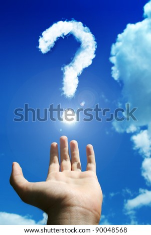 Question mark above the man's hand - stock photo