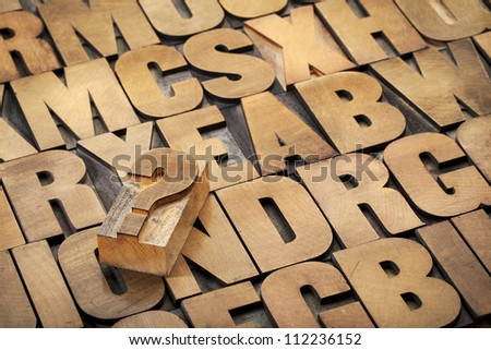 question mark and alphabet in vintage letterpress wood type - stock photo