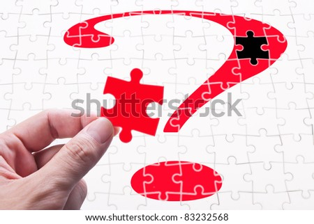 Question mark, human hand and puzzle game. concept of solve problem - stock photo