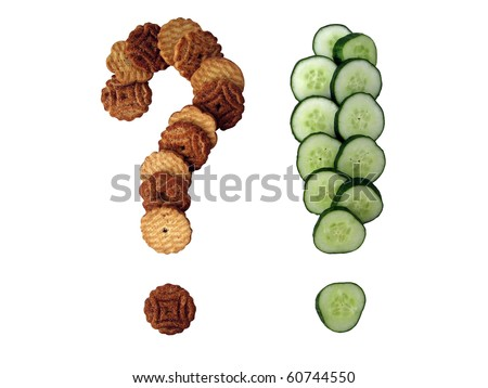Question-mark made of cookies and exclamation mark made of cut cucumbers isolated on white - stock photo