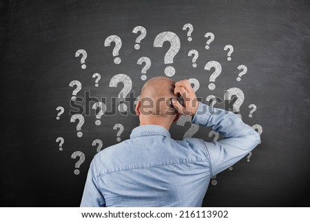 Question Mark on black Blackboard with businessman - stock photo