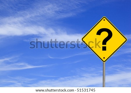 Question mark road sign over brilliant blue sky. - stock photo