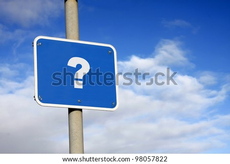 Question mark sign against a blue sky - stock photo