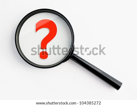 question mark under a magnifying glass, with isolated background - stock photo