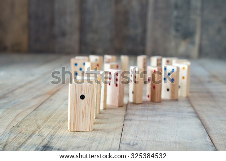 Question symbol of wooden domino - stock photo