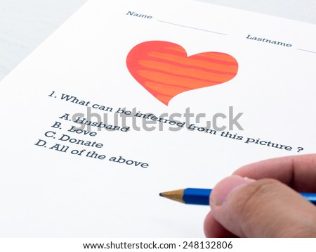 Questionnaire about picture heart and relate word,  filling out answers to a test with a blue pencil. Is this call Love. (Close-up choice) - stock photo