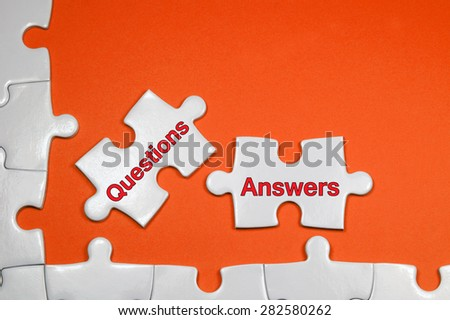 Questions and Answers word on white puzzle - Business Concept - stock photo