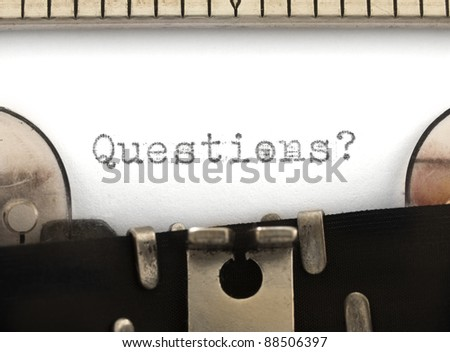 Questions title on the typewriter - stock photo
