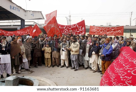 QUETTA, PAKISTAN - DEC 20: Railways employees are protesting in favor of their demands during demonstration at Quetta railway station on Tuesday, December 20, 2011 on Quetta, Pakistan. - stock photo