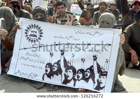 QUETTA, PAKISTAN - JAN 28: Huqooq-e-Teachers Association Balochistan chant slogans and demanding for regularization on their jobs during a protest demonstration on January 28, 2013 in Quetta.