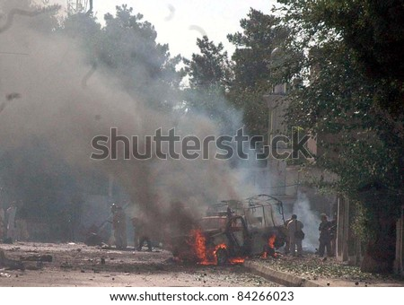 QUETTA, PAKISTAN-SEPT 07: A view of burning FC vehicle which was caught fire in explosions after explosions at the site of twin suicide attacks in Quetta on September 07, 2011.