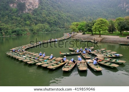 Queue of boats in Tam Coc - Ninh Binh province - Vietnam