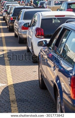 queue of cars at a ferry port