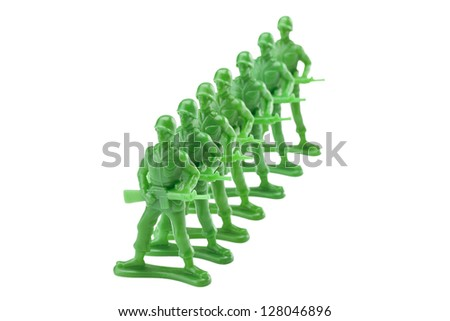 Queue of green plastic toy soldiers isolated in a white background - stock photo