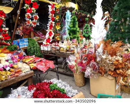 QUEZON CITY, PHILIPPINES - NOVEMBER 22, 2015: A wide variety of home and christmas decorations at a store in Dapitan Market. Dapitan Market is known for its wide variety of home decor products. - stock photo