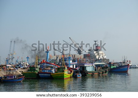 QUI NHON, VIETNAM - MARCH 2016: Boats at Qui Nhon Fish Port in the morning. Qui Nhon is the capital of Binh Dinh Province, known for fishing port parked into a tiny bay and the most nice beaches.