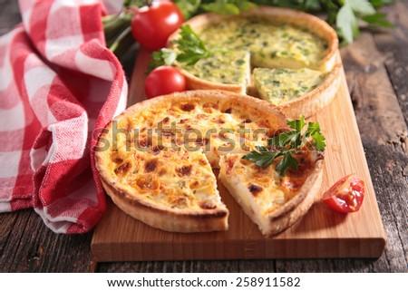 quiche on plank - stock photo