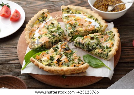 quiche with smoked salmon and spinach, food close-up - stock photo