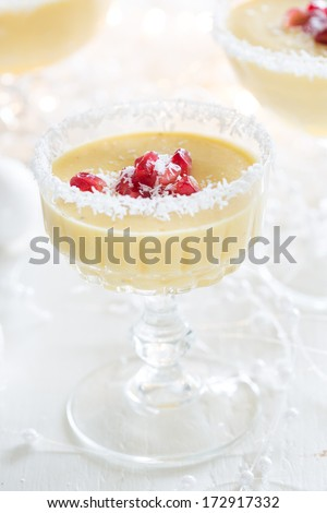 Quick and easy christmas dessert with mango mousse and pomegranate - stock photo