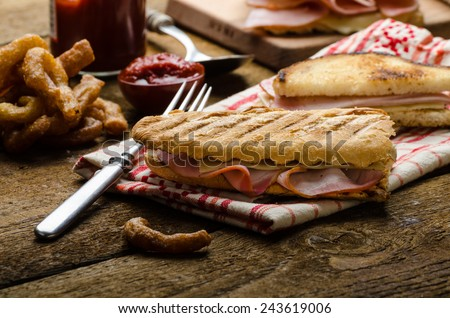 Quick dinner, toast with ham and cheese - panini, english toast, french with butter, dessert delicious churros - stock photo