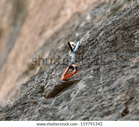 Quickdraw on the rock wall with selective focus - stock photo