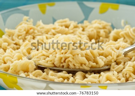 quickly boiled noodles in a plate closeup - stock photo