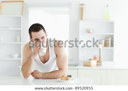 Quiet man having breakfast in his kitchen