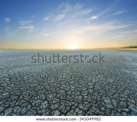 quiet sunset over a dry lands - stock photo